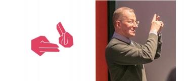 bsl signing logo plus photo of John Wilson