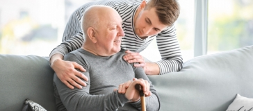 younger and older man talking