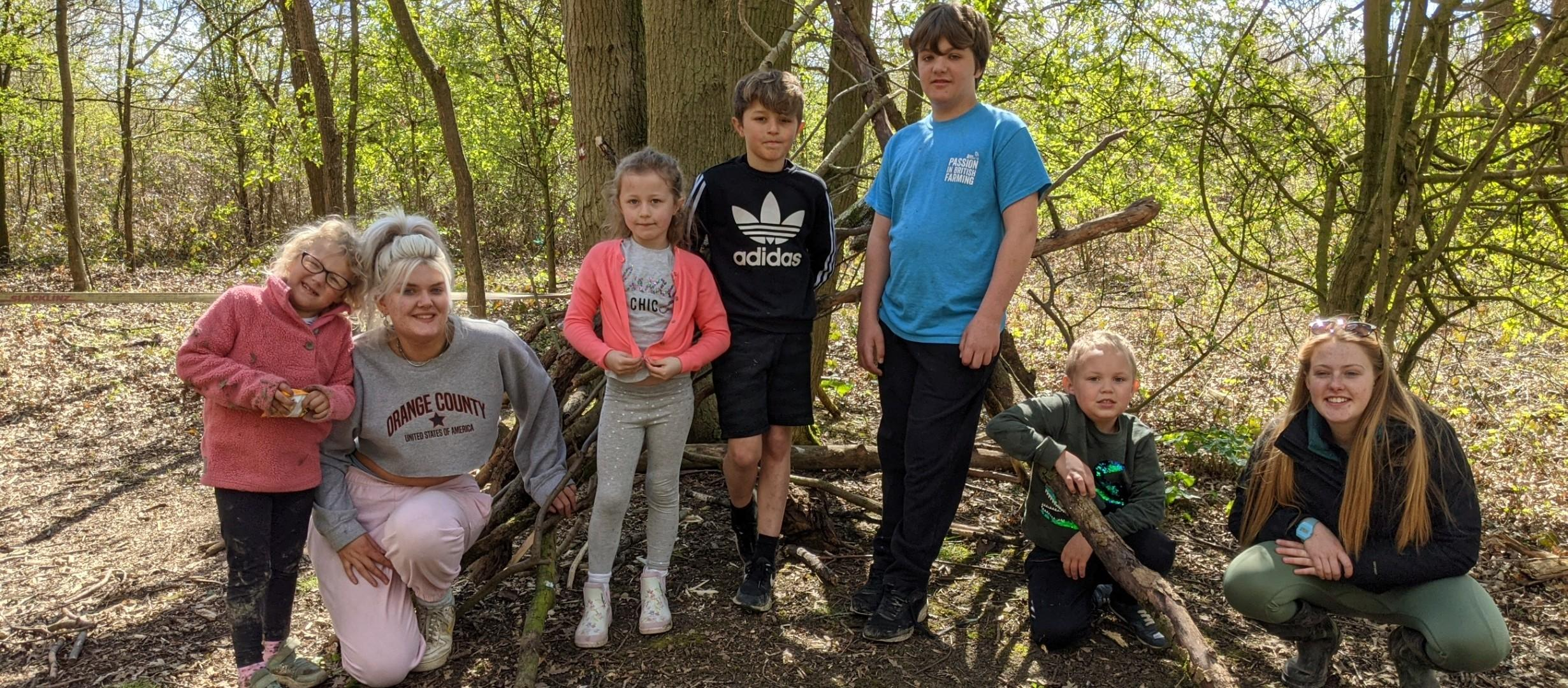 Some young people from WAM building dens in our woodland near Evesham!