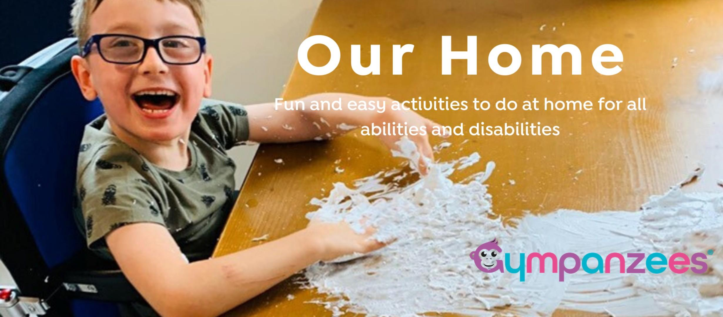 young boy in wheelchair looking very happy doing a craft, text reads 'our home, fun and easy activities to do at home for all abilities and disabilities'