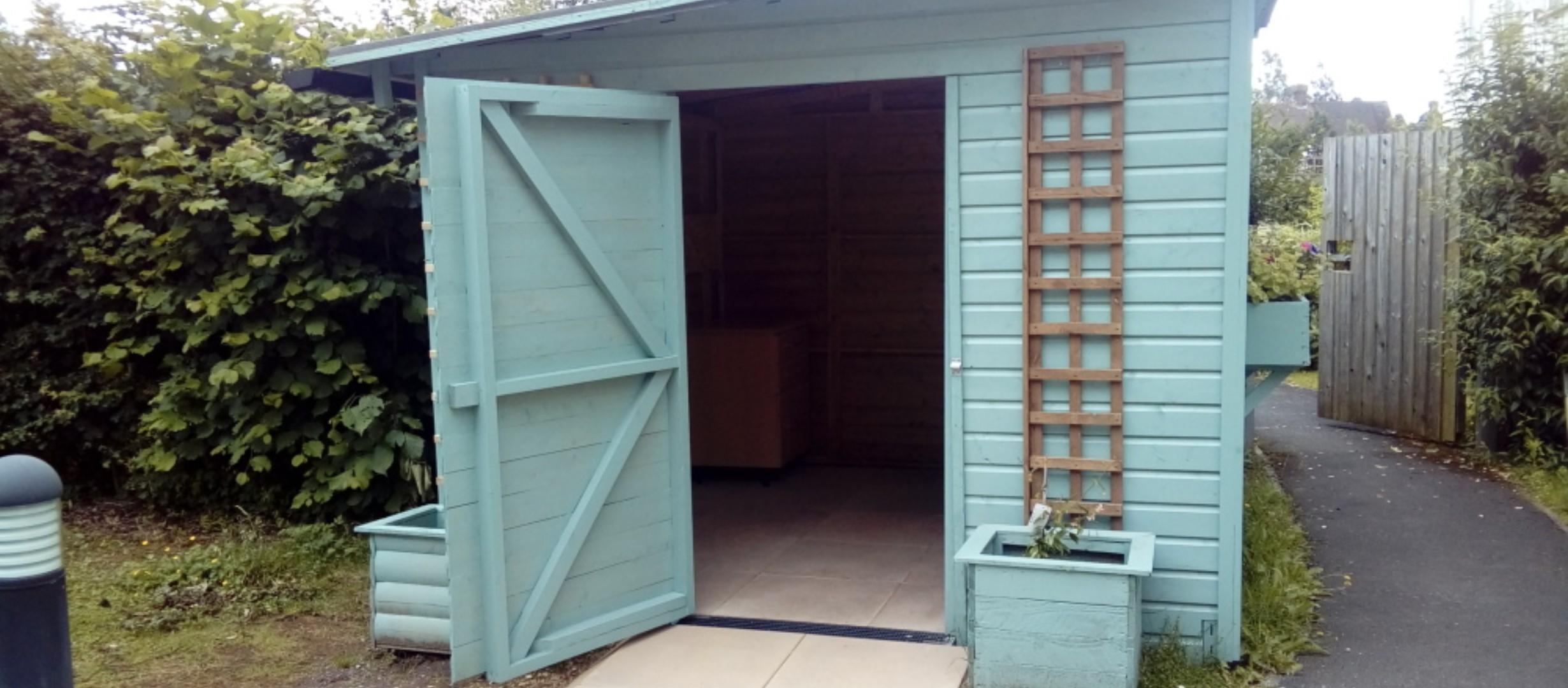 white shed with door open