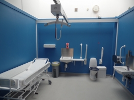 Changing places toilet with changing bench and hoist system