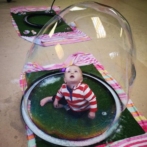 baby inside a bubble sensory play